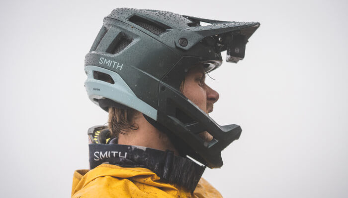 Profile view of man wearing Smith Mainline Helmet and Squad XL goggles