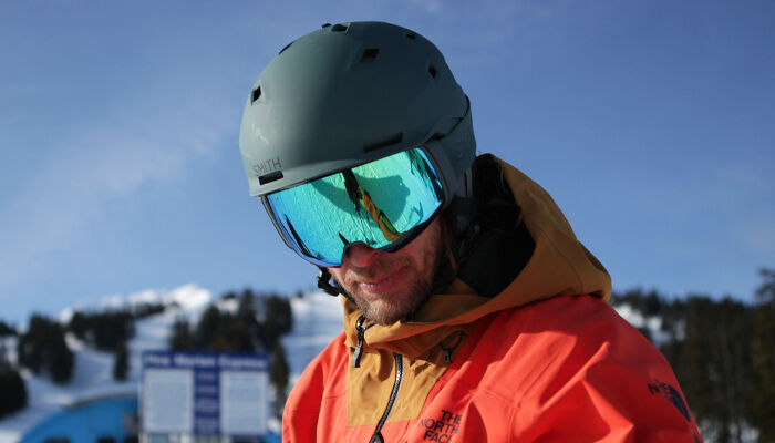 Man wearing Smith snow helmet and goggles